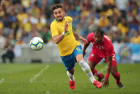 Brazil's Alex Telles runs with the ball away from Panama's Michael Amir Murillo, right, during the friendly soccer match between Brazil and Panama at the Dragao stadium in Porto, Portugal