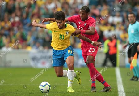 Brazil's Lucas Paqueta fights for the ball with Panama's Michael Amir Murillo, right, during the friendly soccer match between Brazil and Panama at the Dragao stadium in Porto, Portugal