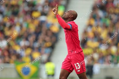 Panama's Adolfo Machado celebrates after scoring his side's first goal during the friendly soccer match between Brazil and Panama at the Dragao stadium in Porto, Portugal