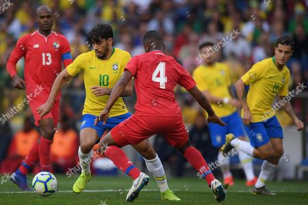 Stock Photo of Brazil's player Lucas Lima (2-L) fights for the ball with Panama?s player Fidel Escobar (C) during their friendly soccer match held at Dragao stadium in Porto, Portugal, 23 March 2019.