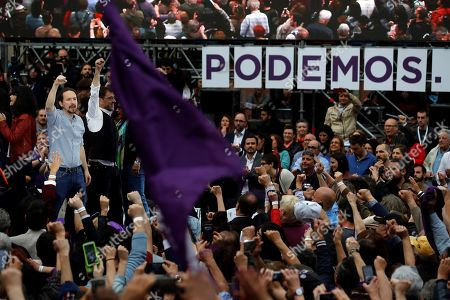 Podemos (We Can) party General Secretary Pablo Iglesias (L) and party co-founder Juan Carlos Monedero (2-L) greet supporters during a party campaign event in Madrid, Spain, 23 March 2019. The Spanish general election will be held on next 28 April.