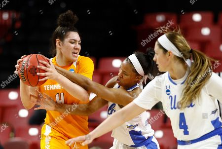 Lajahna Drummer, Mimi Collins, Lindsey Corsaro. Tennessee forward Mimi Collins, left, tries to protect the ball as she is pressured by UCLA forward Lajahna Drummer, center, and guard Lindsey Corsaro in the first half of first-round game in the NCAA women's college basketball tournament, in College Park, Md. UCLA won 89-77