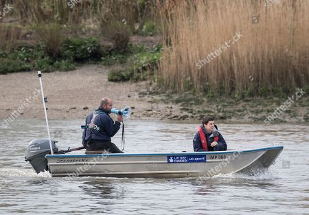 23 March 2019. Boat Race Fixture.  OUWBC vs Molesey BC., Pictured:- OUWBC Head Coach Andy Nelder., As preparation for the The Boat Races, Oxford and Cambridge clubs participate in a number of Fixtures against other clubs, rowing the same Tideway course as used for the Boat Race., OUWBC Crew List (Yellow hulled boat):-, Stroke: Amelia Standing, 7. Tina Christmann, 6. Beth Bridgman, 5. Liv Pryer, 4. Lizzie Polgreen, 3. Renée Koolschijn, 2. Anna Murgatroyd, Bow. Issy Dodds, Cox. Eleanor Shearer