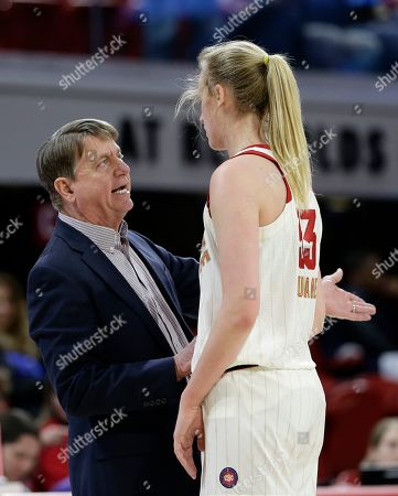 North Carolina State's Elissa Cunane speaks with head coach Wes Moore during the second half of a first round women's college basketball game in the NCAA Tournament in Raleigh, N.C., . North Carolina State won 63-51