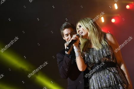 Marta Sanchez (R) and Venezuelan singer Carlos Baute (L) perform on stage during the charity concert 'La Noche de Cadena 100' held at the Wizink Center pavilion in Madrid, Spain, 23 March 2019.