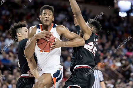 De'Andre Hunter, DJ Laster, Jose Perez. Virginia guard De'Andre Hunter (12) drives to the hoop against Gardner Webb forward DJ Laster (25) and Jose Perez, left, during the first half of a first-round game in the NCAA men's college basketball tournament, in Columbia, S.C. Virginia defeated Gardner-Webb 71-56