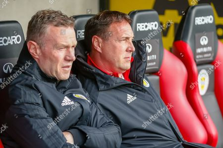 Malky Mackay sits in the Scotland Dugout ahead of the U17 European Championships match between Scotland and Russia at Simple Digital Arena, Paisley