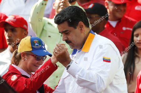 Nicolas Maduro, Cilia Flores. Venezuela's President Nicolas Maduro and first lady Cilia Flores dance during an anti-imperialist rally for the peace, in Caracas, Venezuela