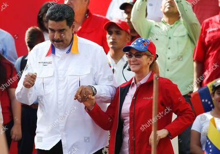 Nicolas Maduro, Cilia Flores. Venezuela's President Nicolas Maduro and his wife Cilia Flores dance during an anti-imperialist rally for peace, in Caracas, Venezuela