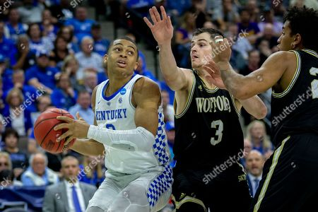 Kentucky guard Keldon Johnson (3) looks to shoot the ball while being defined by Wofford guard Fletcher Magee (3) during the second half of the second round men's college basketball game in the NCAA Tournament, in Jacksonville, Fla