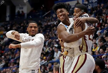 David Nichols, Terance Mann, M.J. Walker. From left, Florida State's David Nichols, Terance Mann and M.J. Walker celebrate at the bench during the second half of a second round men's college basketball game against Murray State in the NCAA Tournament, in Hartford, Conn. Florida State won 90-62