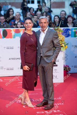 Imanol Arias (R) and partner Irene Meritxell pose upon arrival at the closing of the 22nd Malaga Spanish Film Festival, at the Cervantes Theater, in Malaga, Andalusia, Spain, 23 March 2019.