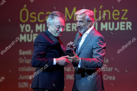 Oscar Martinez (L) receives the Bizanga de Plata to the best actor for 'Y, mi mujer y mi mujer muerta (Me, my wife and my dead wife)' from Spanish actor Imanol Arias (R) during the 22nd Malaga Spanish Film Festival, at the Cervantes Theater, in Malaga, Andalusia, Spain, 23 March 2019.