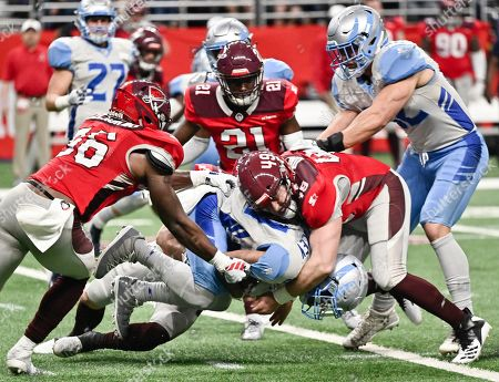 Scott Daly, Sam Mobley. Salt Lake Stallions' Sam Mobley, bottom, is tackled by San Antonio Commanders' Scott Daly (49) during the second half of an AAF football game, at the Alamodome in San Antonio. San Antonio won 19-15