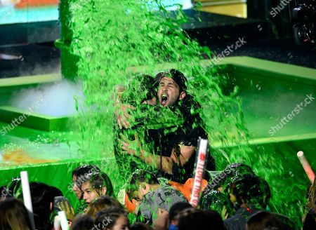 David Dobrik, Josh Peck. David Dobrik, left, and presenter Josh Peck get slimed after Dobrik accepts the award for favorite social star at the Nickelodeon Kids' Choice Awards, at the Galen Center in Los Angeles