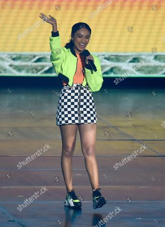 Daniella Perkins waves to the audience as she walks onstage to present the favorite funny TV show award at the Nickelodeon Kids' Choice Awards, at the Galen Center in Los Angeles