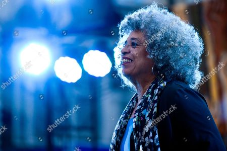 American political activist Angela Davis appears on the stage before speaking during an open air rally in front of the University of the Republic, in Montevideo, Uruguay, . Davis received a Honoris Causa Doctorate degree from the university
