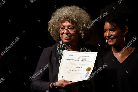 American political activist Angela Davis, left, receives the Honoris Causa from Noelia Ojeda, during an open air rally in front of the University of the Republic in Montevideo, Uruguay