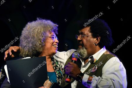 American political activist Angela Davis, left, is embraced by Uruguayan musician Ruben Rada during an open air rally in front of the University of the Republic in Montevideo, Uruguay, . Davis received an Honoris Causa Doctorate degree from the Uruguayan university