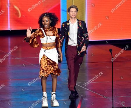 Riele Downs, Jace Norman. Riele Downs, left, and Jace Norman walk onstage to present the award for favorite female artist at the Nickelodeon Kids' Choice Awards, at the Galen Center in Los Angeles