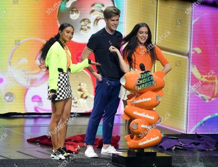 Stock Picture of Daniella Perkins, Owen Joyner, Lilimar Hernandez. Daniella Perkins, from left, Owen Joyner and Lilimar present the favorite funny TV show award at the Nickelodeon Kids' Choice Awards, at the Galen Center in Los Angeles
