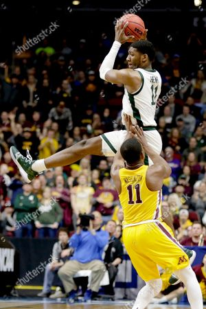 Michigan State's Aaron Henry (11) leaps for a high ball over Minnesota's Isaiah Washington (11) during the second half of a second round men's college basketball game in the NCAA Tournament, in Des Moines, Iowa