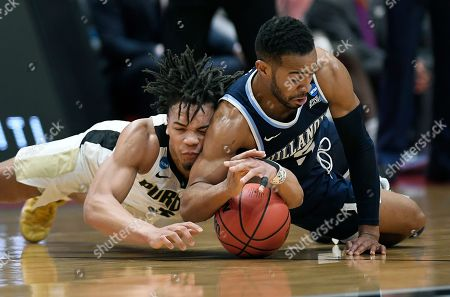 Purdue's Carsen Edwards, left, and Villanova's Phil Booth dive for a loose ball during the first half of a second round men's college basketball game in the NCAA tournament, in Hartford, Conn