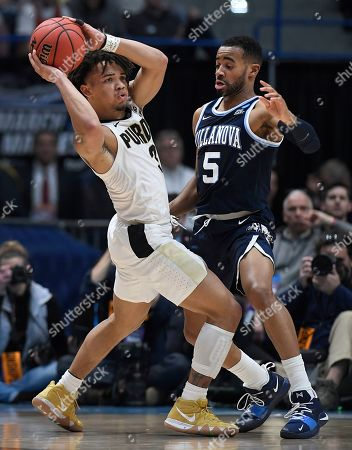 Purdue's Carsen Edwards (3) is guarded by Villanova's Phil Booth (5) during the first half of a second round men's college basketball game in the NCAA tournament, in Hartford, Conn