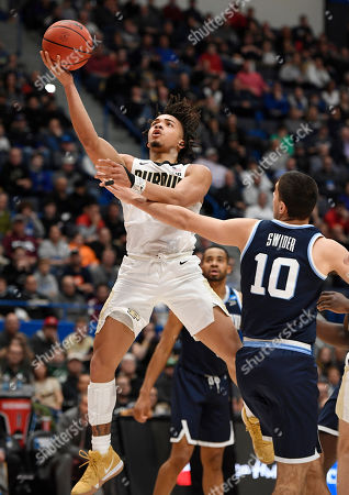 Purdue's Carsen Edwards (3) is fouled by Villanova's Cole Swider (10) during the second half of a second round men's college basketball game in the NCAA tournament, in Hartford, Conn