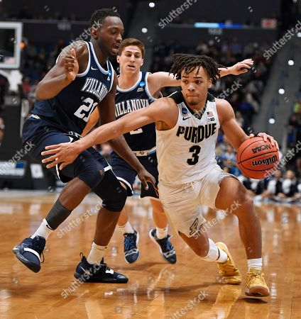 Purdue's Carsen Edwards, right, dribbles around Villanova's Dhamir Cosby-Roundtree, left and Villanova's Collin Gillespie, back, during the second half of a second round men's college basketball game in the NCAA tournament, in Hartford, Conn