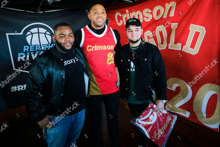 Stock Photo of Houston Rocket and former Indiana University Player, Eric Gordon joined Dove Men+Care to give out limited-edition Crimson & Gold #REPtheRIVALRY Jerseys and bring rivals together during March Madness, at Hopcat on in Indianapolis