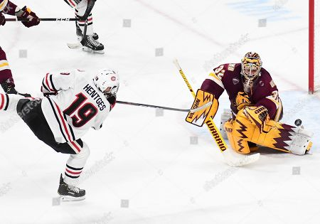 St. Cloud State Huskies forward Sam Hentges (19) fires a shot on Minnesota-Duluth Bulldogs goaltender Hunter Shepard (32) during the NCHC Frozen Faceoff championship between the Minnesota Duluth Bulldogs and the St. Cloud State Huskies at the Xcel Energy Center, St. Paul, MN. Duluth defeated St. Cloud State 3-2 in double overtime