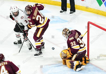 Minnesota-Duluth Bulldogs goaltender Hunter Shepard (32) blocks a shot by St. Cloud State Huskies forward Jack Poehling (3) in overtime of the NCHC Frozen Faceoff championship between the Minnesota Duluth Bulldogs and the St. Cloud State Huskies at the Xcel Energy Center, St. Paul, MN. Duluth defeated St. Cloud State 3-2 in double overtime
