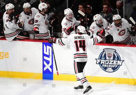 Stock Photo of St. Cloud State Huskies forward Patrick Newell (14) gets congratulations from the bench after scoring a goal during the NCHC Frozen Faceoff championship between the Minnesota Duluth Bulldogs and the St. Cloud State Huskies at the Xcel Energy Center, St. Paul, MN. Duluth defeated St. Cloud State 3-2 in double overtime