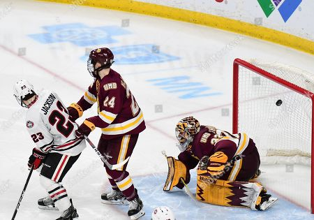 A St. Cloud State Huskies forward Patrick Newell (14) shot sails past Minnesota-Duluth Bulldogs goaltender Hunter Shepard (32) in the third period of the NCHC Frozen Faceoff championship between the Minnesota Duluth Bulldogs and the St. Cloud State Huskies at the Xcel Energy Center, St. Paul, MN. Duluth defeated St. Cloud State 3-2 in double overtime