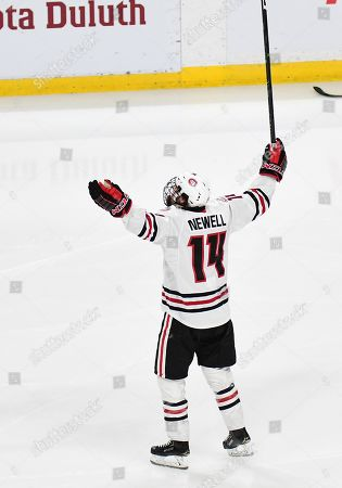 St. Cloud State Huskies forward Patrick Newell (14) celebrates after scoring during the NCHC Frozen Faceoff championship between the Minnesota Duluth Bulldogs and the St. Cloud State Huskies at the Xcel Energy Center, St. Paul, MN. Duluth defeated St. Cloud State 3-2 in double overtime