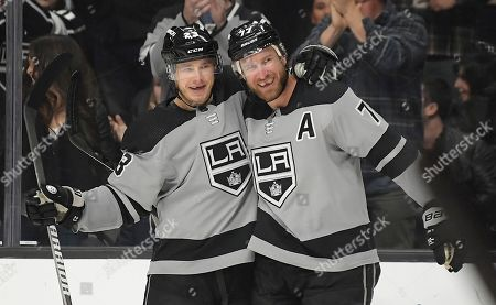 Jeff Carter, Dustin Brown. Los Angeles Kings center Jeff Carter, right, celebrates his goal with right wing Dustin Brown during the second period of the team's NHL hockey game against the Anaheim Ducks, in Los Angeles