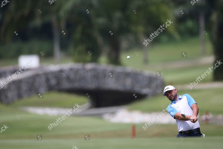 Andy Sullivan of England chips to the 6th green at the final round of the Malaysia Golf Championship in Kuala Lumpur, Malaysia