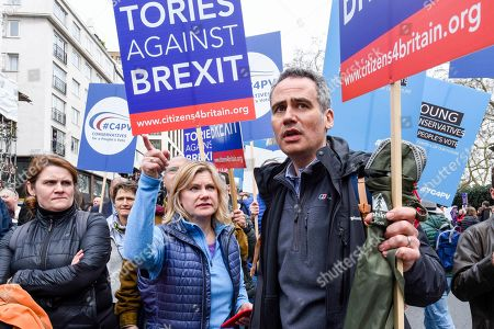 """LONDON, UK. Justine Greening (C), MP for Putney, takes part in the march. Thousands of people take part in the """"Put It To The People March"""", marching from Park Lane to Parliament Square on what was supposed to be six days before the UK was due to leave the EU, before an extension to the departure date was given. Protesters demand that the public is given a final say on Brexit as support for the Prime Minister's withdrawal plan continues to recede."""
