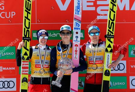 Stock Picture of (L-R) Men's World Cup's Standings second placed Stefan Kraft of Austria, winner Ryoyu Kobayashi of Japan and third placed Kamil Stoch of Poland celebrate after the World Cup's Ski Flying Hill Individual Final HS 240 in Planica, Slovenia, 24 March 2019.