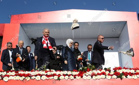 Turkish President Recep Tayyip Erdogan (R), his wife Emine (4-R), candidate of (AK Party) for Istanbul mayor Binali Yildirim (4-L) and MHP leader Devlet Bahceli (2-L) throw presents to their supporters during Turkey's ruling Justice and Development Party (AK Party) and Nationalist Movement Party (MHP) local election campaign rally in Istanbul, Turkey, 24 March 2019. Local elections in Turkey's capital and the country's overall 81 provinces are scheduled for 31 March 2019.