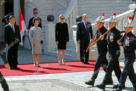 Prince Albert II of Monaco (R), Princess Charlene (2R), Chinese President Xi Jinping (L) and his wife Peng Liyuan (2L)    at the Royal Palace in Monaco, 24 March 2019. Chinese President is in Monaco for a one day state visit.
