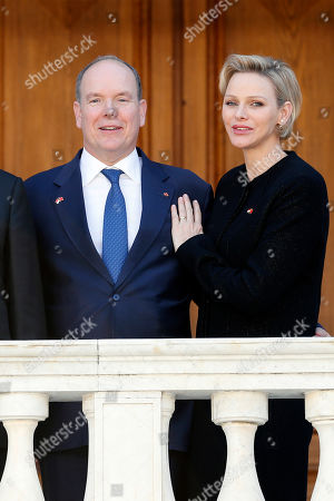 Prince Albert II of Monaco (L) and Princess Charlene (R) pose for photographs at the Royal Palace after a meeting with Chinese President in Monaco, 24 March 2019. Chinese President is in Monaco for a one day state visit.