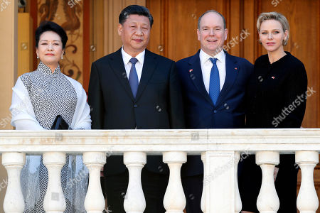 Prince Albert II of Monaco (2-R), Princess Charlene (R), Chinese President Xi Jinping (2L) and his wife Peng Liyuan (L) pose for photographs at the Royal Palace after a meeting in Monaco, 24 March 2019. Chinese President is in Monaco for a one day state visit.
