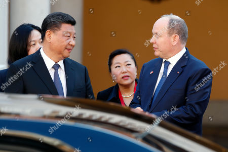 Prince Albert II of Monaco (R) and Chinese President Xi Jinping (L) speak at the Royal Palace after their meeting in Monaco, 24 March 2019. Chinese President is in Monaco for a one day state visit.