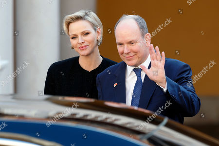 Prince Albert II of Monaco (R), Princess Charlene (L) wave as Chinese President Xi Jinping (unseen) leaves the Royal Palace after a meeting in Monaco, 24 March 2019. Chinese President is in Monaco for a one day state visit.