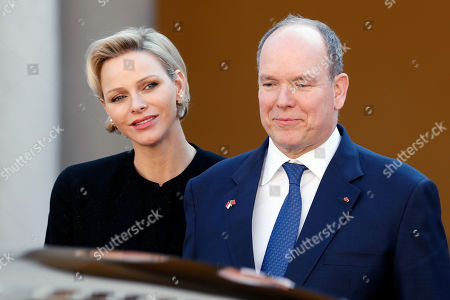 Prince Albert II of Monaco (R), Princess Charlene (L) look as Chinese President Xi Jinping (unseen) leaves the Royal Palace after a meeting in Monaco, 24 March 2019. Chinese President is in Monaco for a one day state visit.