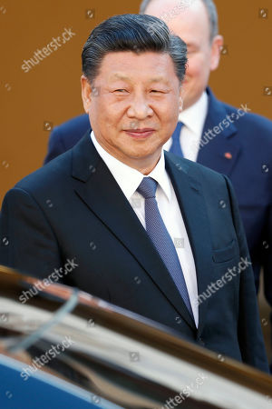 Chinese President Xi Jinping (C) leaves the Royal Palace after a meeting with Prince Albert II of Monaco in Monaco, 24 March 2019. Chinese President is in Monaco for a one day state visit.