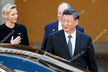 Chinese President Xi Jinping (C) leaves the Royal Palace after a meeting with Prince Albert II of Monaco (CL) and Princess Charlene (L) in Monaco, 24 March 2019. Chinese President is in Monaco for a one day state visit.