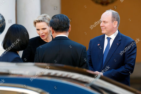 Prince Albert II of Monaco (R) and Princess Charlene (2L) speak with Chinese President Xi Jinping (CB) as he leaves the Royal Palace after a meeting in Monaco, 24 March 2019. Chinese President is in Monaco for a one day state visit.